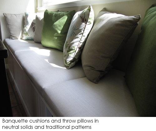 Neutral fabrics: Banquette cushions and throw pillows