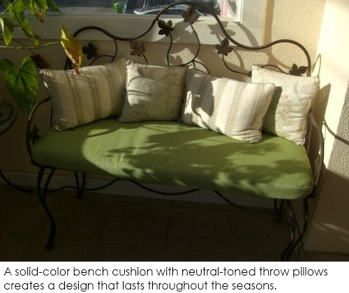 Neutral fabrics: Solid bench cushion with muted throw pillows
