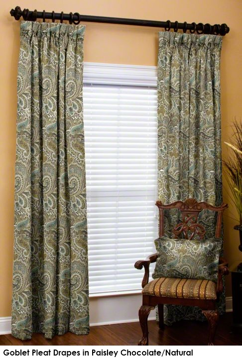 Drapes in paisley green fabric