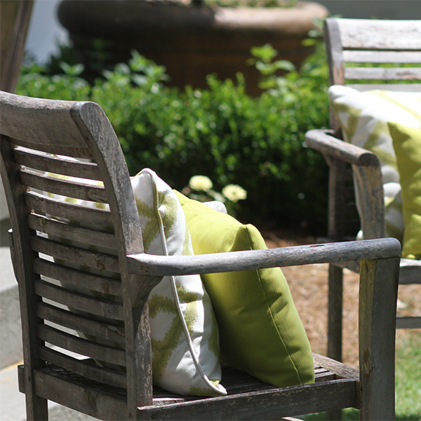 Pro-tip: New throw pillows are an inexpensive way to give your old furniture a facelift.