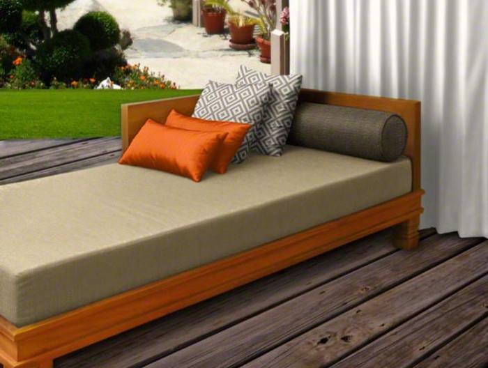 Custom daybed cushion with pillows and outdoor drape.