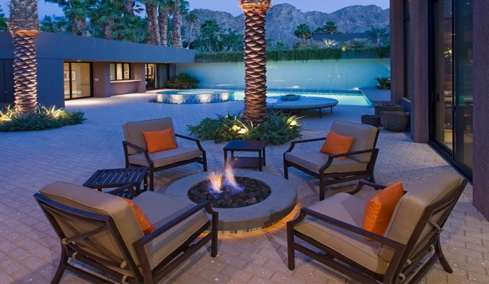 Aim to entertain: Make sure there is enough seating with deep seating chair cushions with throw pillows on the patio.