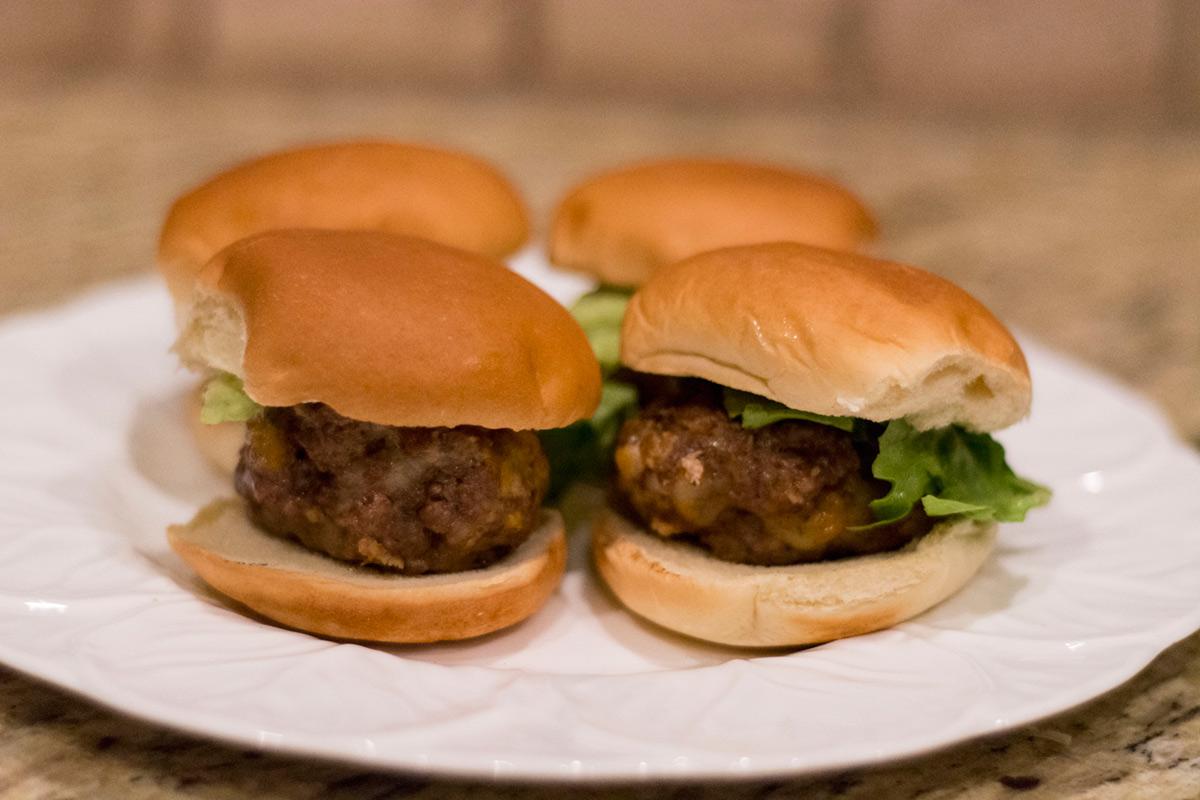 Stuffed Meatball Sliders are easy tailgate food.